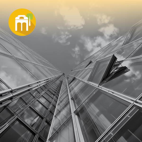 צילום של בנינים מלמטה על רקע השמיים ואייקון של חנויות ונותני שירותים