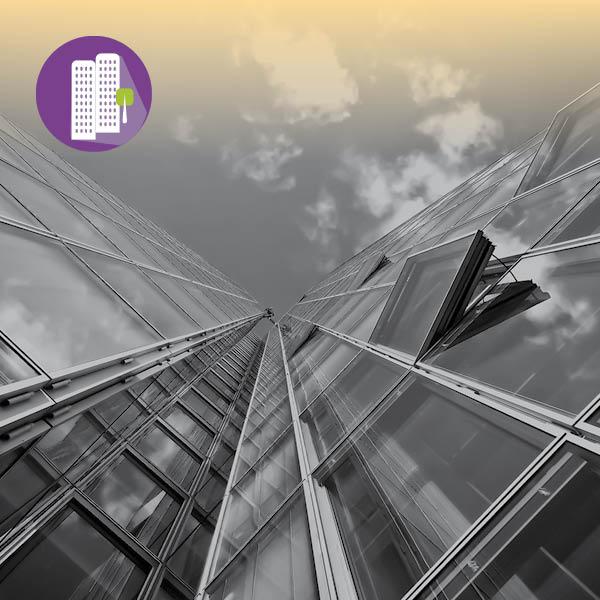 צילום של בנינים מלמטה על רקע השמיים ואייקון של תאגידים